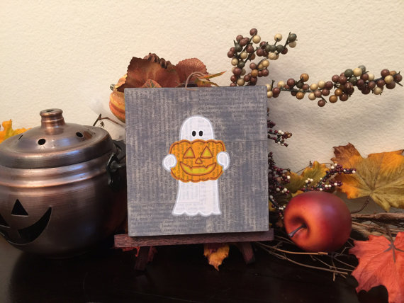 Ghost with Pumpkin, by Geoffrey and Laura Long - www.mysterybarn.com